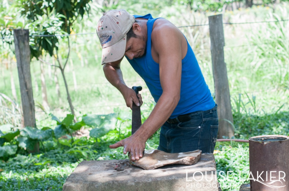 Sharpening the edges of the machete on a stone