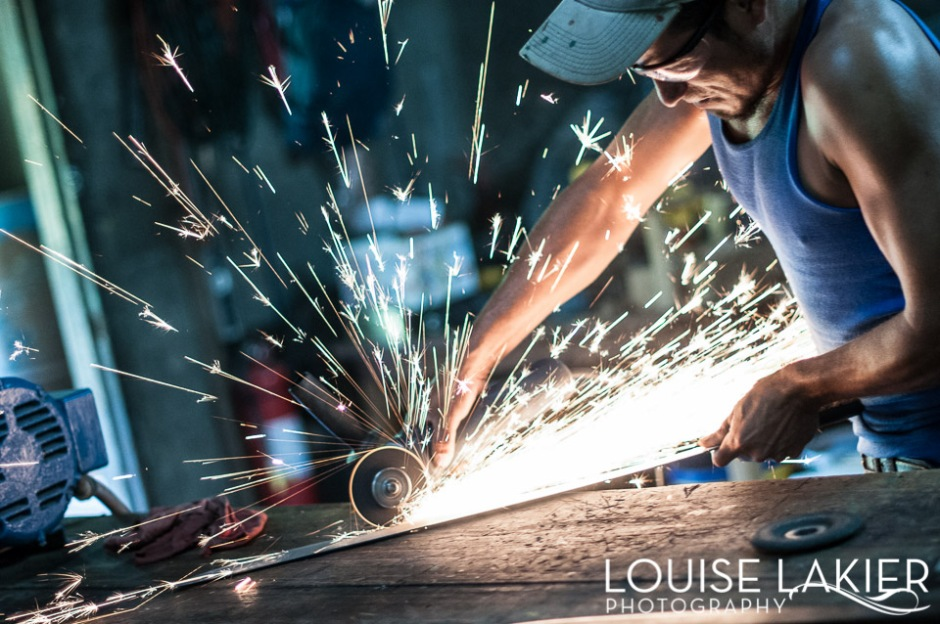 Sparks fly while cutting the machete down to size with an angle grinder
